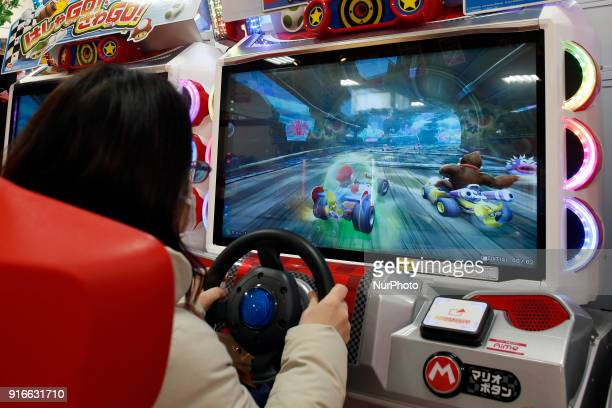 A woman playing Nintendo Super Mario Kart in Tokyo Japan February 10 2018