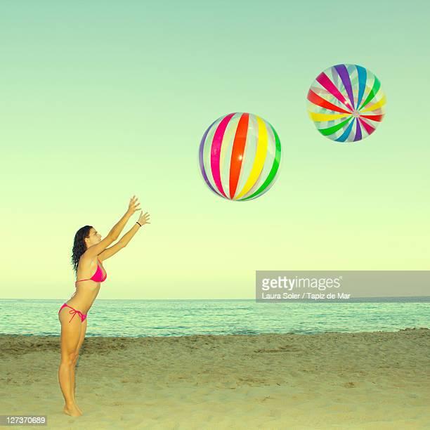 Woman playing on beach