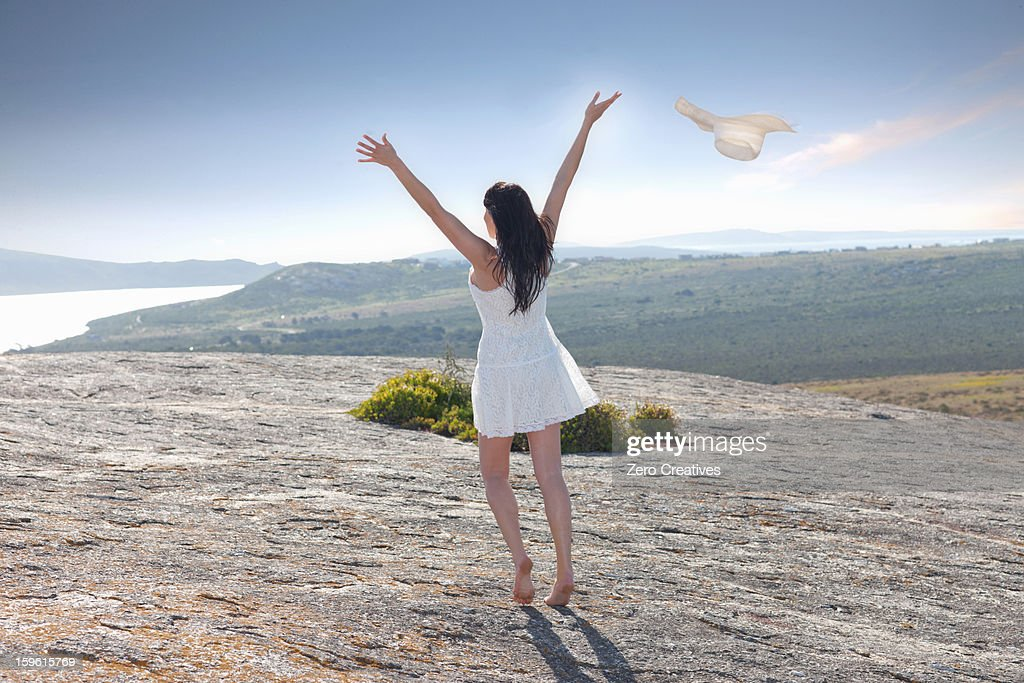 Woman playing on rock formation : Stock Photo