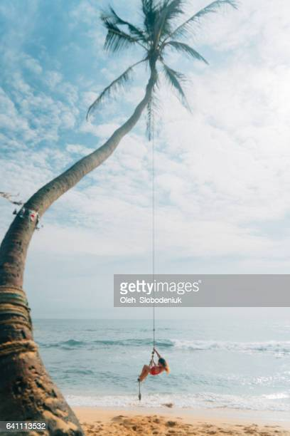 Woman playing on rope swing
