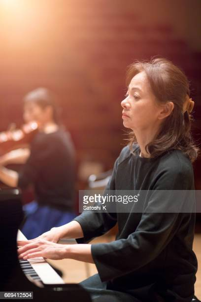 Woman playing piano on concert