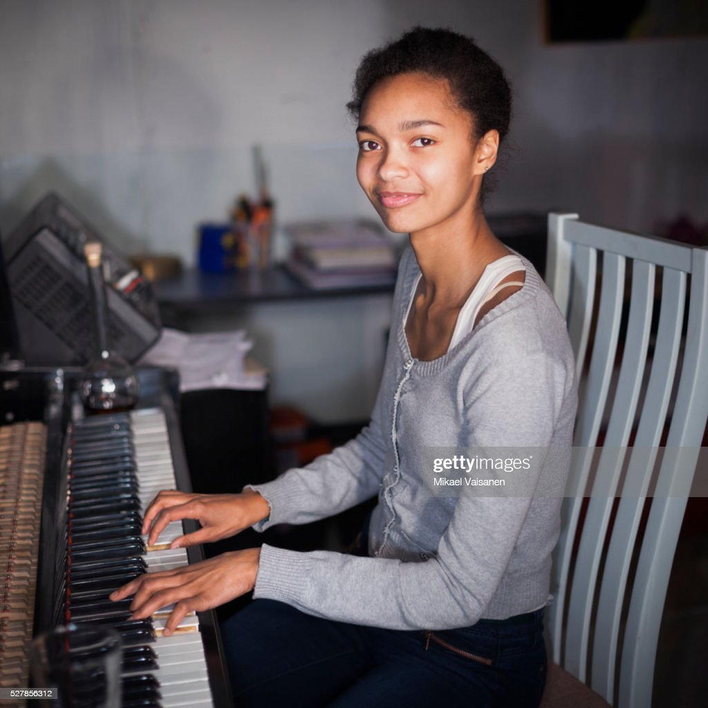 woman playing piano : Stock Photo