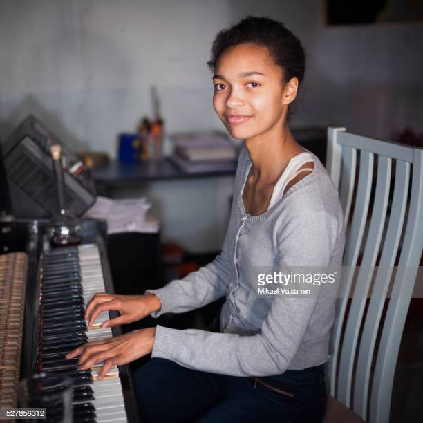 woman playing piano - keyboard player stock photos and pictures