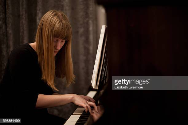 woman playing piano - pianist stock pictures, royalty-free photos & images