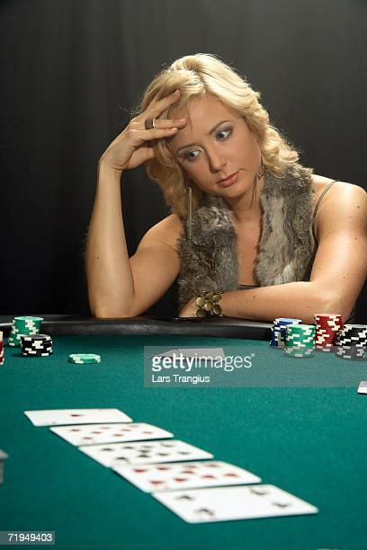 a woman playing poker. - gambling table stock pictures, royalty-free photos & images