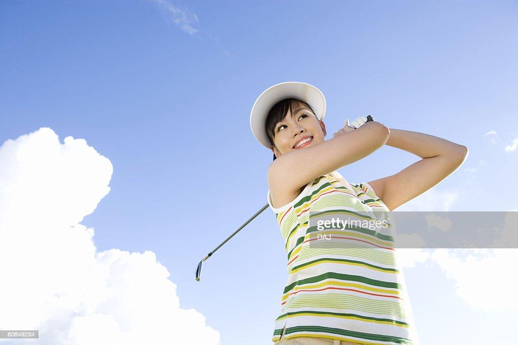 Woman playing shot under the blue sky, Saipan, USA  : ストックフォト