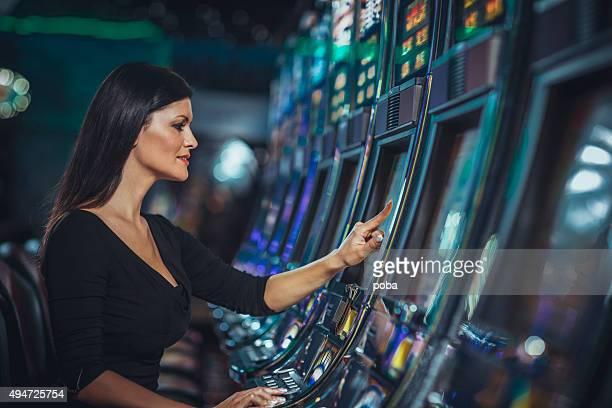 woman playing slot machine in casino