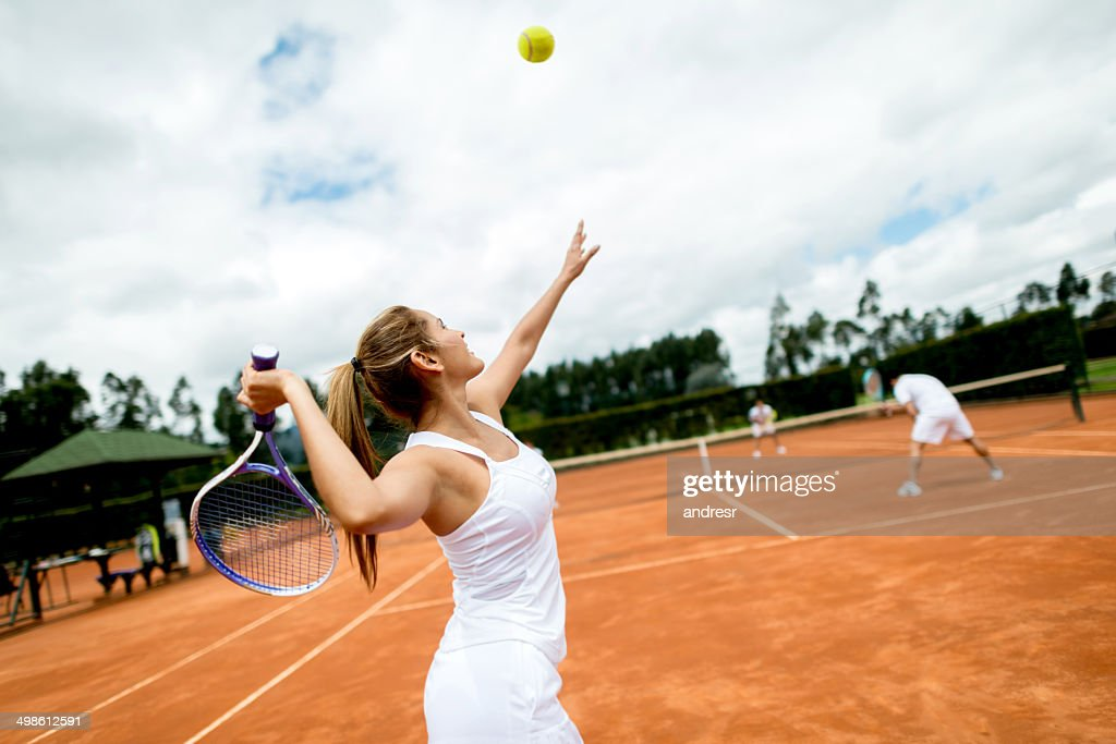 Woman playing tennis : Stock Photo