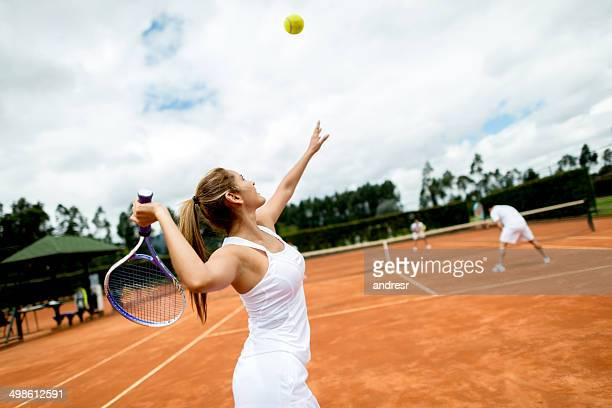 woman playing tennis - doubles stock photos and pictures