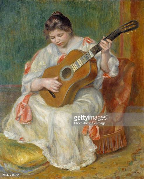 Woman playing the guitar Painting by PierreAuguste Renoir 1897 Oil on canvas81 x 065 m Beaux Arts Museum Lyon France
