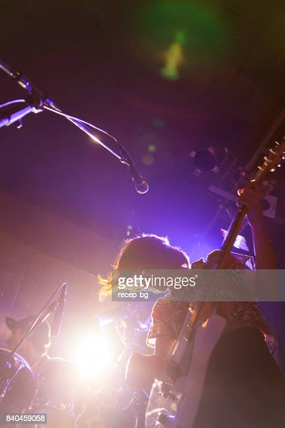 woman playing the guitar - heavy metal stock photos and pictures