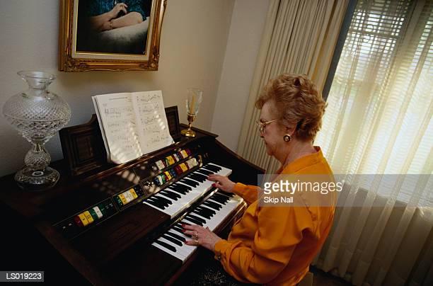 Woman Playing the Organ