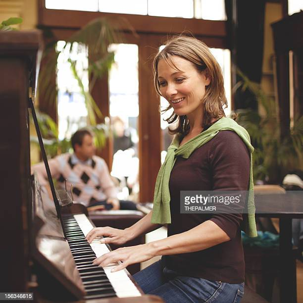 woman playing the piano - keyboard player stock photos and pictures