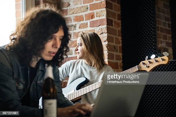 Woman playing thoughtful a guitar