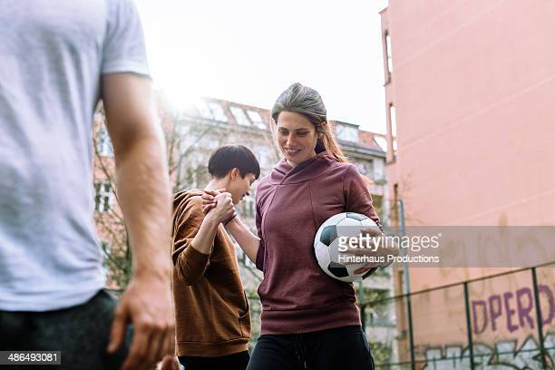 woman playing urban soccer - fußball stock-fotos und bilder