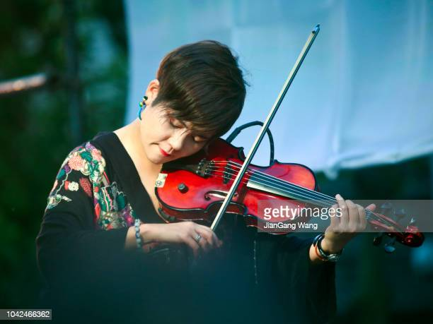 woman playing violin at noge's jazz de bon odori 2018 - violin family stock photos and pictures