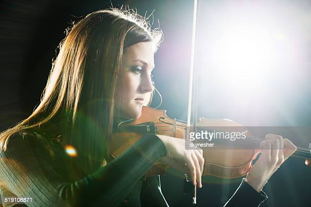 woman playing violin. - soloist stock photos and pictures