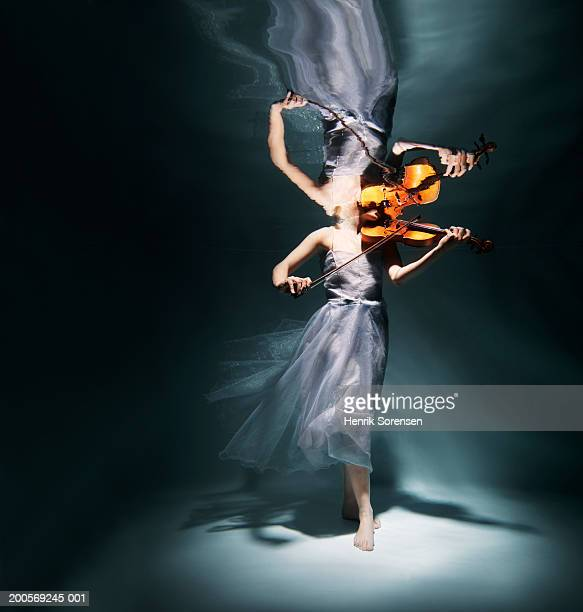 Woman playing violin underwater (low section)