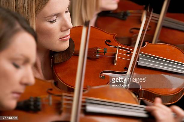 Woman Playing Violins