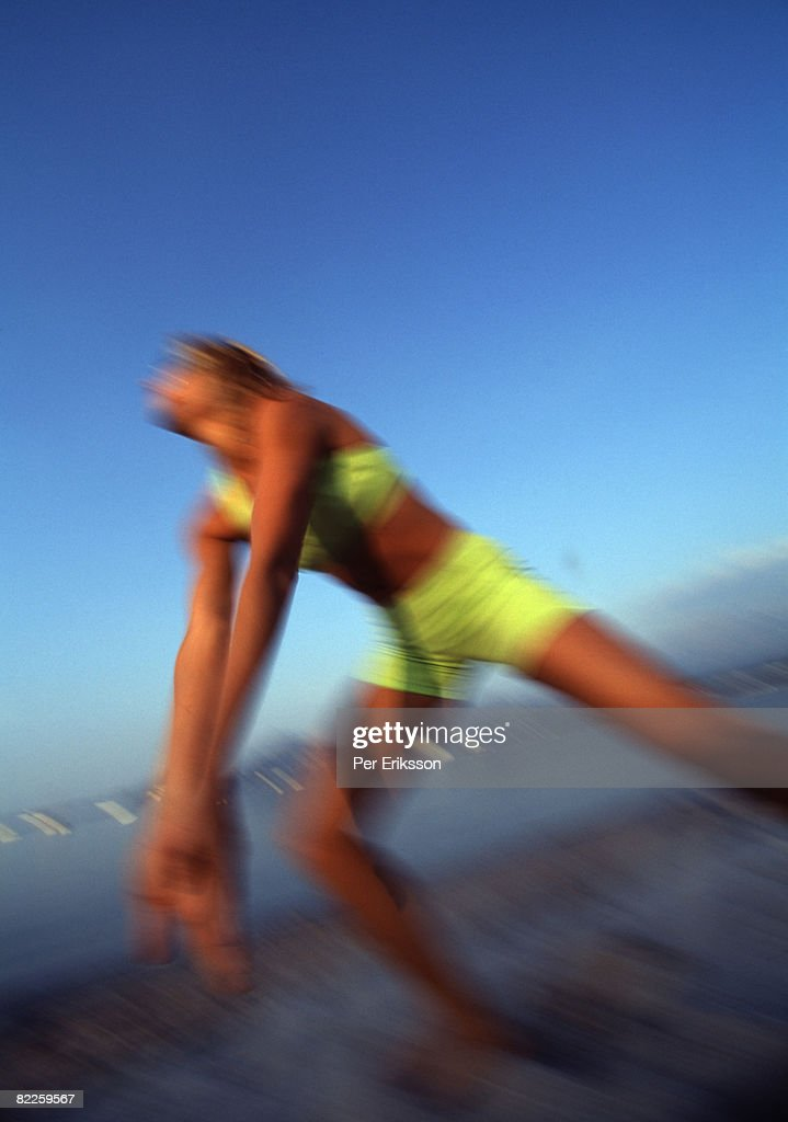 A woman playing volleyball. : Stock Photo