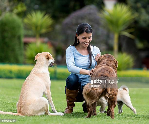 Woman playing with adopted dogs