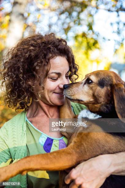 Woman playing with dogs on the backyard