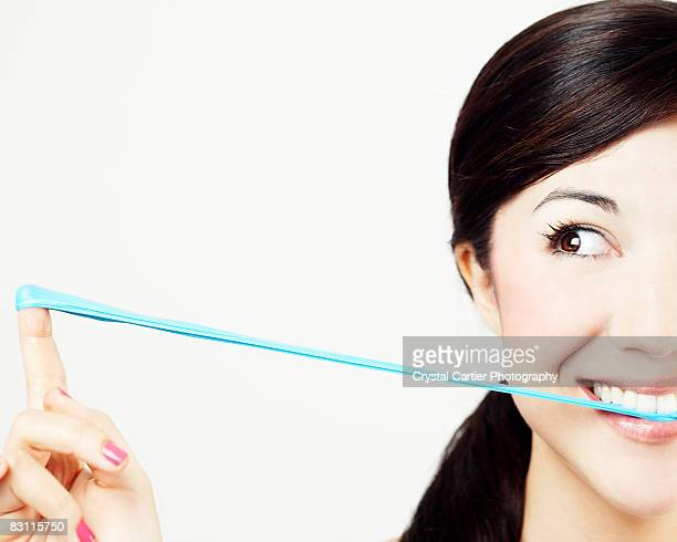Woman playing with gum