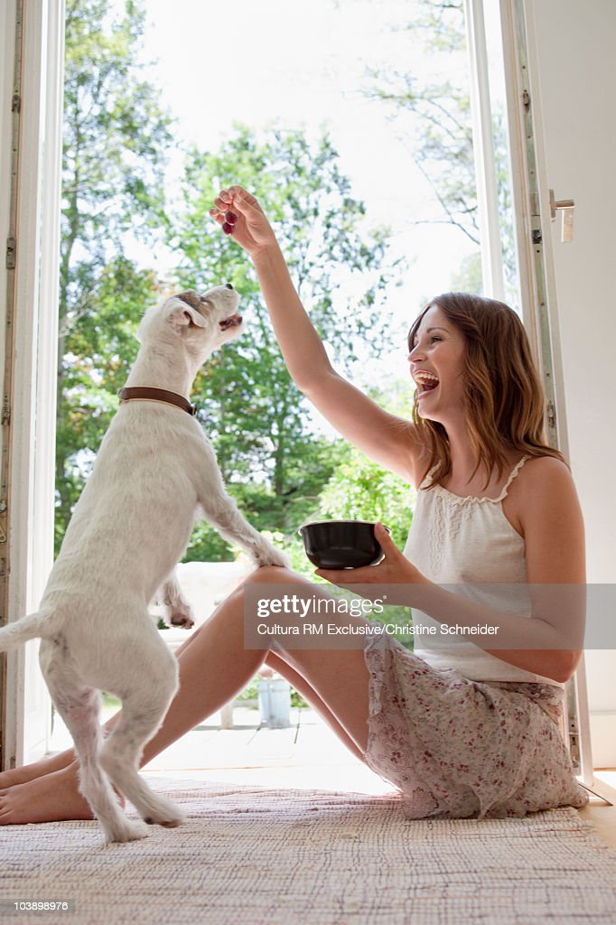 Woman playing with her dog : Stock Photo