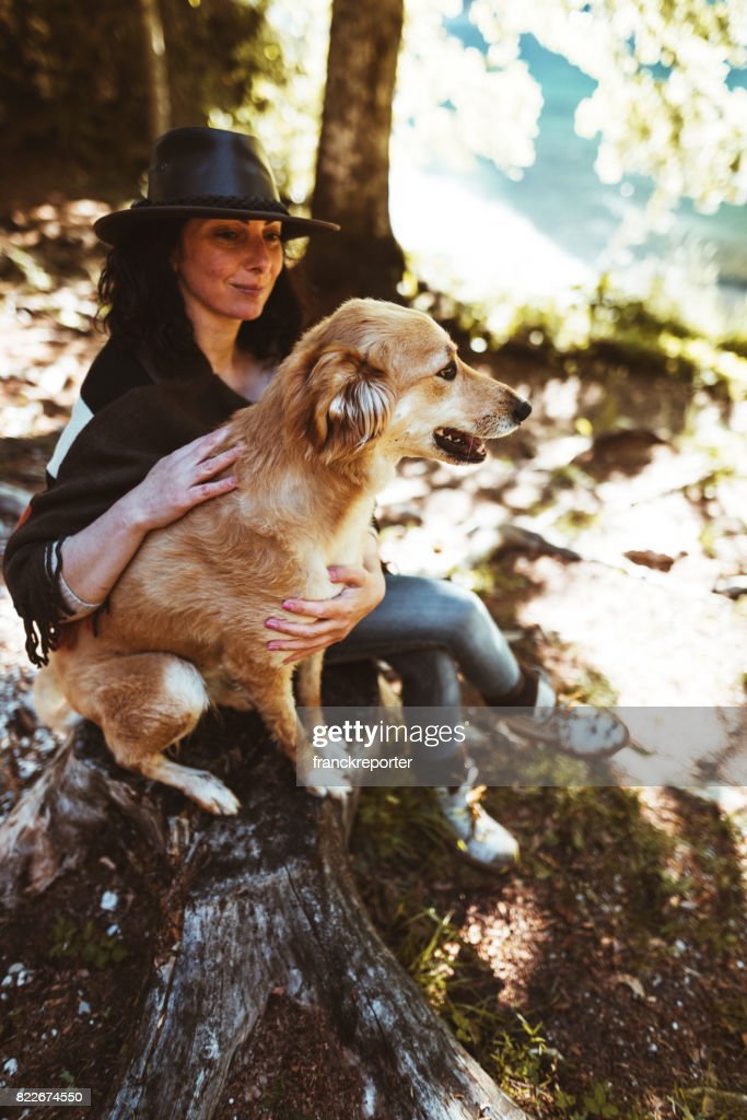 woman playing with the dog in the mountain : Stock Photo
