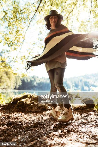 woman playing with the dog in the mountain - animal costume stock pictures, royalty-free photos & images