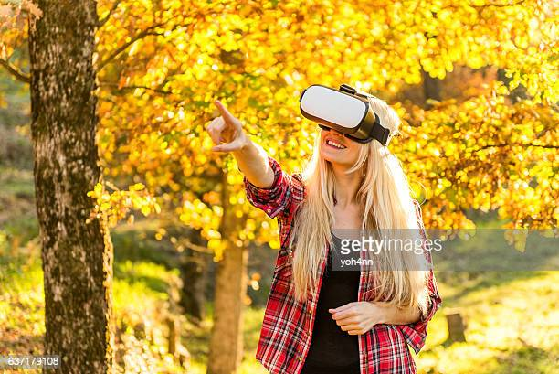 Woman playing with Vr outdoors