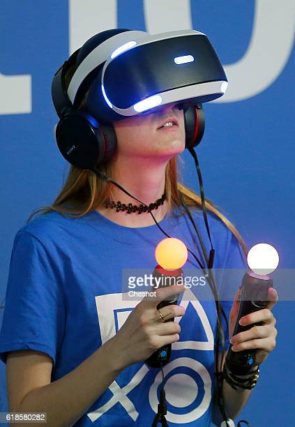 A woman plays a video game with a virtual reality headmounted headset 'PlayStation VR' developed by Sony Interactive Entertainment during the 'Paris...