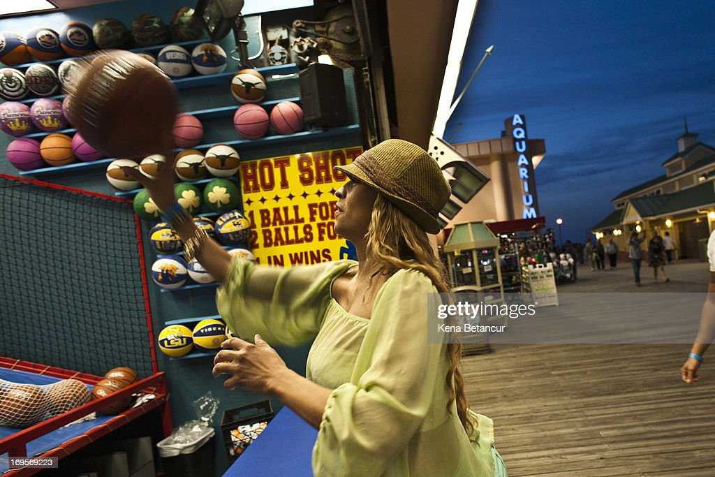 A woman plays basketball in the arcade at Point Pleasant Beach on the first weekend of New Jersey beaches re-opening to the public on May 27, 2013 in Point Pleasant, New Jersey. The region continues to recover and rebuild after Hurricane Sandy devastated parts of the coastline.