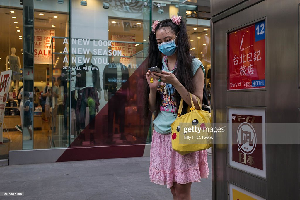 A woman plays Pokemon Go on her smartphone on August 8, 2016 in Taipei, Taiwan. 'Pokemon Go,' which has been a smash-hit across the globe was launched in Taiwan on 6th August. Since its global launch, the mobile game has been an unexpected megahit among users who have taken to the streets with their smartphones.