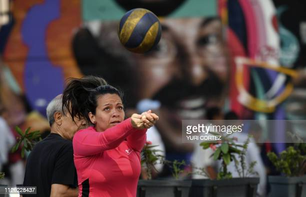 A woman plays volleyball in the street during an 'antiimperialist day' in support of Venezuelan President Nicolas Maduro in Caracas on February 20...