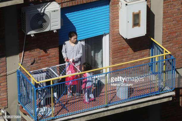 A woman plays with her daughter on the balcony of their home during lockdown on March 23 2020 in Rome Italy As Italy extends its nationwide lockdown...