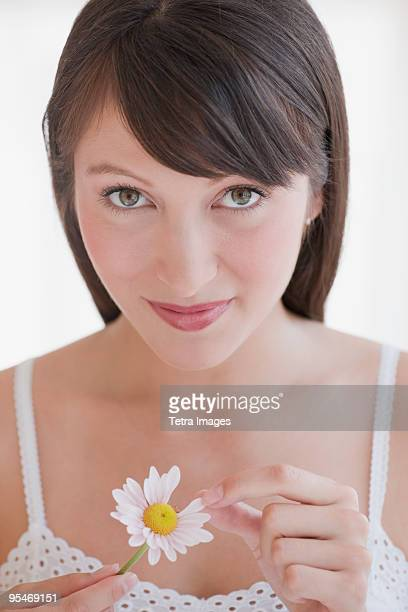 Woman plucking daisy