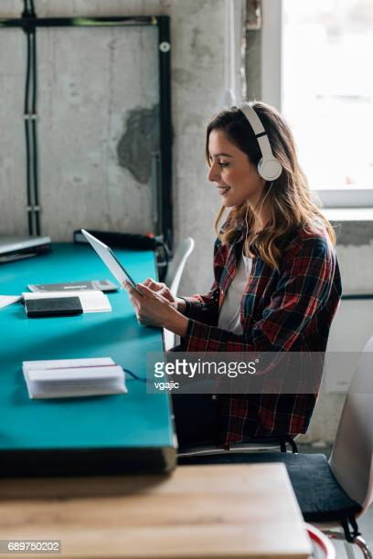 Woman podcasting in modern office