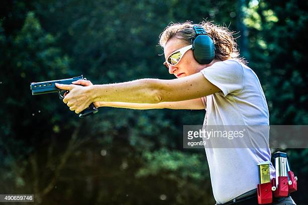 Woman pointing a gun