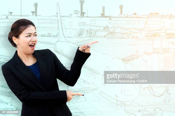 Woman Pointing Against Drawing