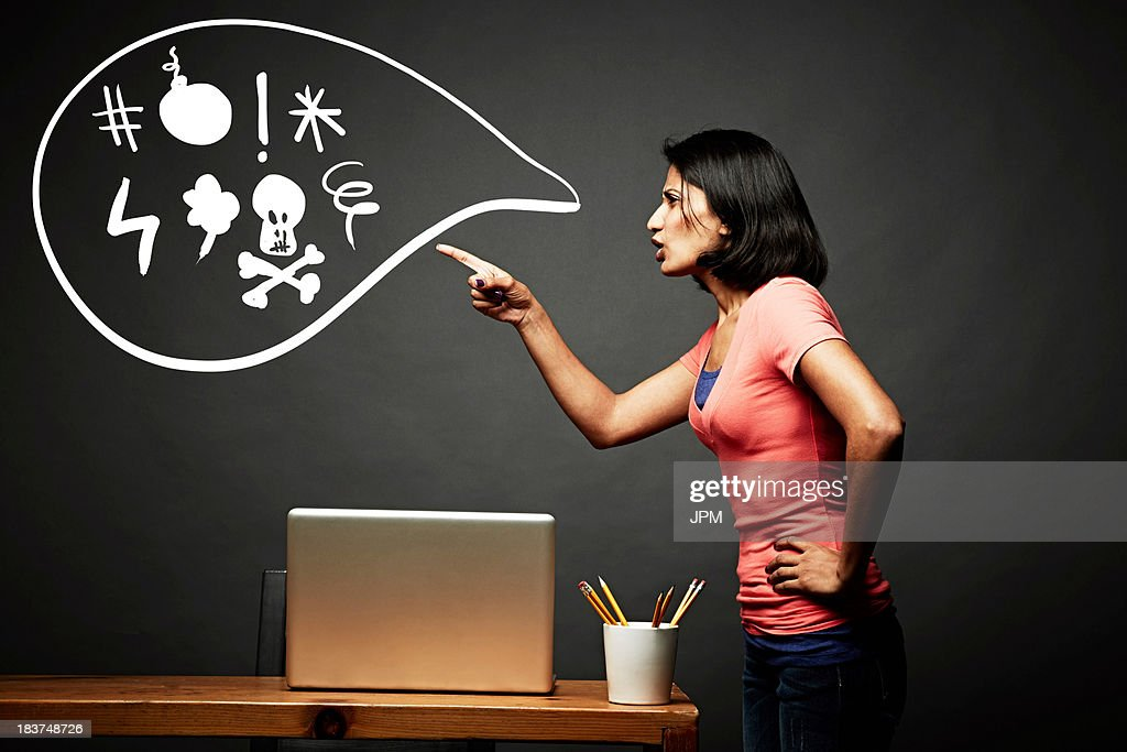 Woman pointing and shouting offensively : Stock Photo