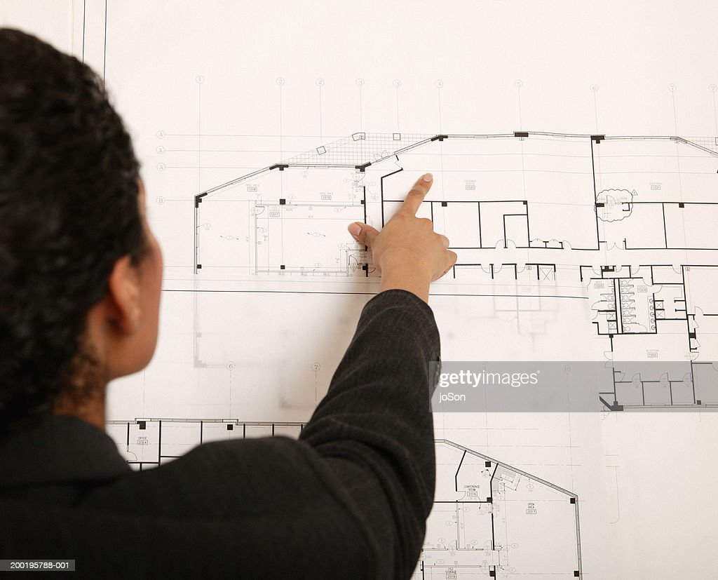 Woman pointing at detail on blueprint rear view stock photo getty woman pointing at detail on blueprint rear view stock photo malvernweather Images