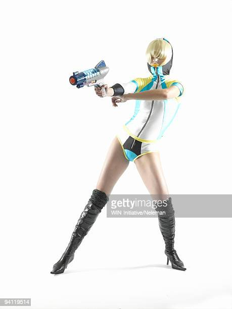 woman pointing with a handgun - studio shot ストックフォトと画像