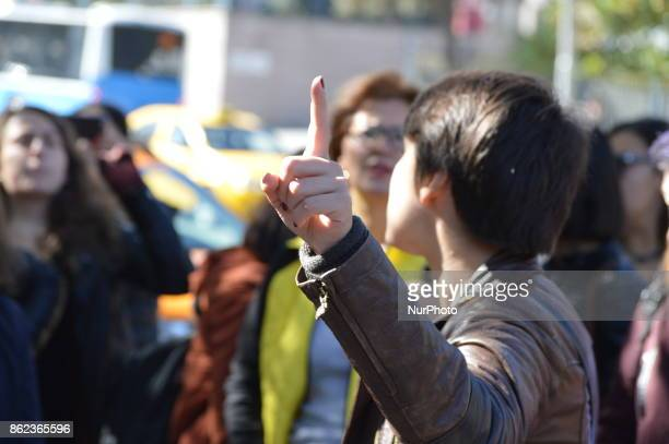 A woman points police as Turkish riot policemen disperse woman protesters who were going to march to the Grand National Assembly of Turkey to protest...