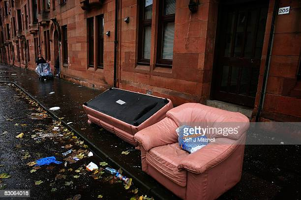 A woman points towards some discarded furniture in a street on September 30 2008 in the Govan area of Glasgow Scotland A report by the Campaign to...