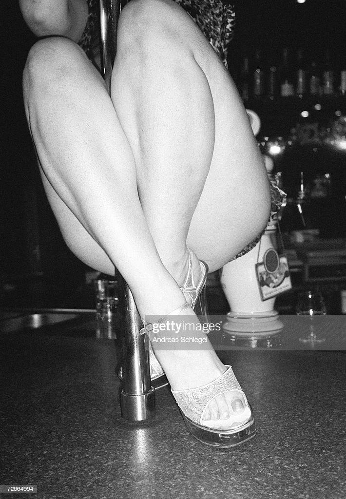Woman pole dancing on bar counter : Stock Photo