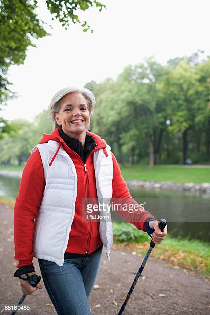 a woman pole walking sweden. - northern european descent stock pictures, royalty-free photos & images