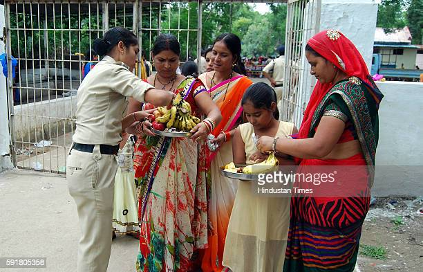 A woman police carrying out a strict checking of ladies who came to visit their prisoner brothers at Central Jail on the auspicious occasion of...