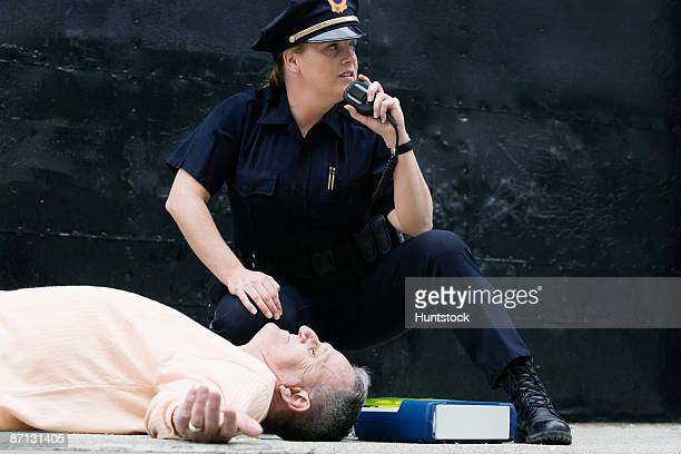 Woman police officer asking for assistance on the hand mike