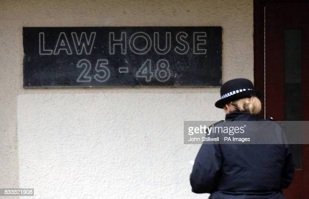 A woman police officer stands outside Law House on Maybury Road Barking which Essex police have cordoned off this morning following the discovery of...